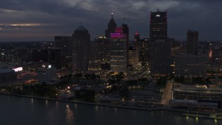 DX0002_193_002 - 5.7K stock footage aerial video orbit tall downtown skyscrapers at twilight, Downtown Detroit, Michigan
