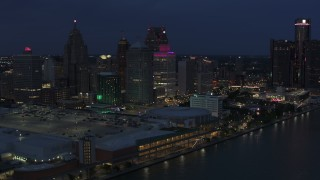DX0002_193_005 - 5.7K stock footage aerial video orbit skyscrapers at twilight, reveal GM Renaissance Center, Downtown Detroit, Michigan
