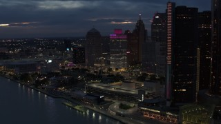 DX0002_193_008 - 5.7K stock footage aerial video orbit a group of tall skyscrapers at twilight, reveal GM Renaissance Center, Downtown Detroit, Michigan