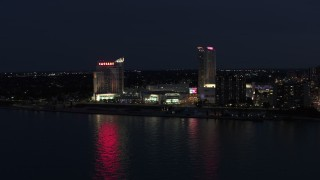 DX0002_193_013 - 5.7K stock footage aerial video of flying by Caesar Windsor hotel and casino at night, Windsor, Ontario, Canada