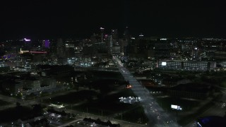 DX0002_193_022 - 5.7K stock footage aerial video a wide view of the city's skyline at night, Downtown Detroit, Michigan