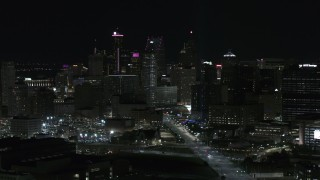 DX0002_193_028 - 5.7K stock footage aerial video of flying by the skyscrapers in the skyline at night, Downtown Detroit, Michigan