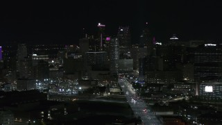 DX0002_193_029 - 5.7K stock footage aerial video of passing by the skyscrapers in the skyline at night, Downtown Detroit, Michigan