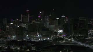 DX0002_193_031 - 5.7K stock footage aerial video of the tall towers in the skyline at night, Downtown Detroit, Michigan
