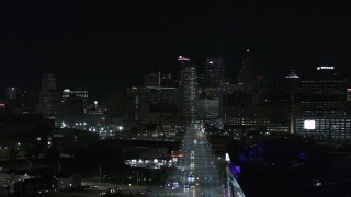 DX0002_193_032 - 5.7K stock footage aerial video of the skyline at night during descent over Grand River Avenue, Downtown Detroit, Michigan