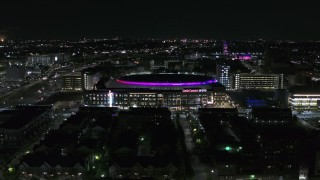 DX0002_193_037 - 5.7K stock footage aerial video approach and fly away from Little Caesars Arena at night, Detroit, Michigan