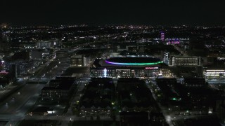 DX0002_193_038 - 5.7K stock footage aerial video of approaching Little Caesars Arena at night, Detroit, Michigan