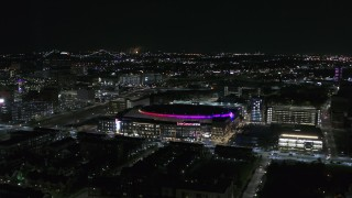 DX0002_193_039 - 5.7K stock footage aerial video of orbiting Little Caesars Arena at night, Detroit, Michigan