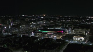 DX0002_193_040 - 5.7K stock footage aerial video of circling Little Caesars Arena at night, Detroit, Michigan