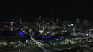 DX0002_193_048 - 5.7K stock footage aerial video slowly approach the skyline, Ford Field and Comerica Park at night, Downtown Detroit, Michigan