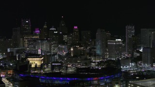 DX0002_193_051 - 5.7K stock footage aerial video ascend from Comerica Park and skyline at night, Downtown Detroit, Michigan