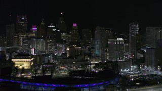 DX0002_193_054 - 5.7K stock footage aerial video fly past skyline at night, reveal Comerica Park, Downtown Detroit, Michigan