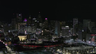 DX0002_193_055 - 5.7K stock footage aerial video fly past and away from Comerica Park and skyline at night, Downtown Detroit, Michigan