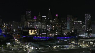 DX0002_193_056 - 5.7K stock footage aerial video fly past Comerica Park and skyline at night, Downtown Detroit, Michigan