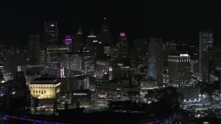 DX0002_193_057 - 5.7K stock footage aerial video the downtown skyline seen from baseball stadium at night, Downtown Detroit, Michigan