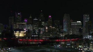 DX0002_193_058 - 5.7K stock footage aerial video descending by Comerica Park and skyline at night, Downtown Detroit, Michigan