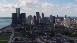 DX0002_194_006 - 5.7K stock footage aerial video of passing by GM Renaissance Center and the city's skyline, Downtown Detroit, Michigan