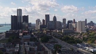 DX0002_194_007 - 5.7K stock footage aerial video descend and flyby GM Renaissance Center and the city's skyline, Downtown Detroit, Michigan