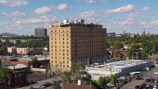DX0002_194_014 - 5.7K stock footage aerial video of orbiting an apartment building in Detroit, Michigan