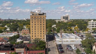 DX0002_194_016 - 5.7K stock footage aerial video of slowly orbiting an apartment building in Detroit, Michigan