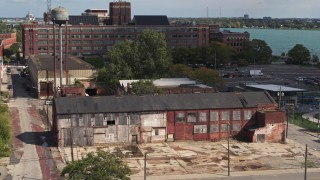 DX0002_194_021 - 5.7K stock footage aerial video ascend by an abandoned factory building in Detroit, Michigan