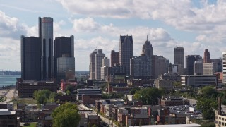DX0002_194_022 - 5.7K stock footage aerial video of towering GM Renaissance Center and the skyline in Downtown Detroit, Michigan