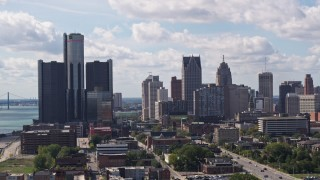 DX0002_194_023 - 5.7K stock footage aerial video of ascending past towering GM Renaissance Center and the skyline in Downtown Detroit, Michigan