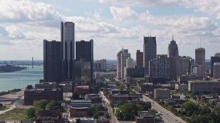 DX0002_194_025 - 5.7K stock footage aerial video of descending past towering GM Renaissance Center and the skyline in Downtown Detroit, Michigan