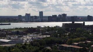 DX0002_194_040 - 5.7K stock footage aerial video of a wide view of the skyline of Windsor, Ontario, Canada seen from Detroit side of the river