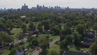 DX0002_195_007 - 5.7K stock footage aerial video of the skyline seen from the Heidelberg Project art display and urban homes in Detroit, Michigan