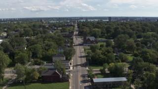 DX0002_195_012 - 5.7K stock footage aerial video of orbiting a church on Mt Elliott Street in an urban neighborhood, Detroit, Michigan