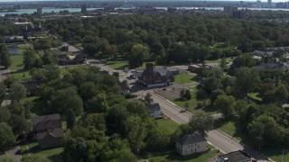 DX0002_195_013 - 5.7K stock footage aerial video ascend over urban homes to orbit a church on Mt Elliott Street, Detroit, Michigan