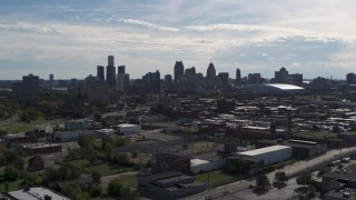 DX0002_195_016 - 5.7K stock footage aerial video of the city's skyline seen from brick industrial buildings, Downtown Detroit, Michigan