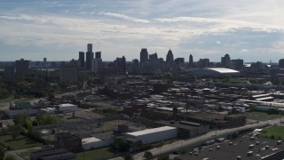 DX0002_195_017 - 5.7K stock footage aerial video wide view of the city's skyline seen from brick industrial buildings, Downtown Detroit, Michigan