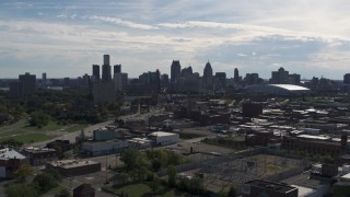 DX0002_195_019 - 5.7K stock footage aerial video ascend toward the city's skyline from brick industrial buildings, Downtown Detroit, Michigan