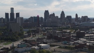 DX0002_195_028 - 5.7K stock footage aerial video focus on the city's skyline while flying past brick buildings, Downtown Detroit, Michigan