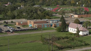 DX0002_195_030 - 5.7K stock footage aerial video orbit and approach a police station in Detroit, Michigan