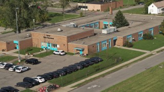 DX0002_195_031 - 5.7K stock footage aerial video orbit and fly away from a police station in Detroit, Michigan