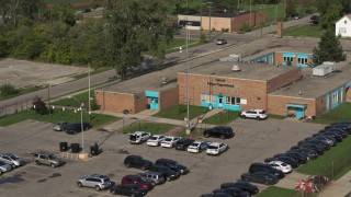DX0002_195_032 - 5.7K stock footage aerial video of the front entrance of a police station in Detroit, Michigan