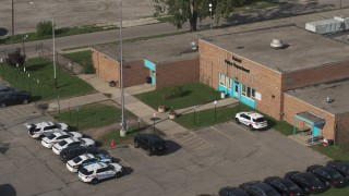 DX0002_195_033 - 5.7K stock footage aerial video of the police station's front entrance in Detroit, Michigan