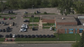 DX0002_195_034 - 5.7K stock footage aerial video reverse view of the police station's front entrance in Detroit, Michigan
