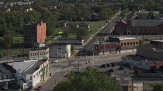 DX0002_195_039 - 5.7K stock footage aerial video orbit a street intersection with abandoned buildings and shops in Detroit, Michigan