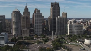 DX0002_196_003 - 5.7K stock footage aerial video orbit towering skyscrapers across from Hart Plaza, Downtown Detroit, Michigan