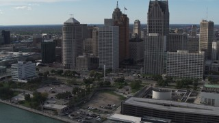 DX0002_196_014 - 5.7K stock footage aerial video of orbiting tall city skyscrapers behind Hart Plaza, Downtown Detroit, Michigan