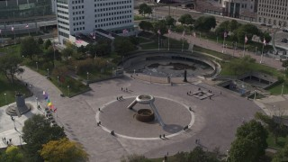 DX0002_196_023 - 5.7K stock footage aerial video orbit and approach fountain in Hart Plaza in Downtown Detroit, Michigan