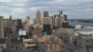 DX0002_196_025 - 5.7K stock footage aerial video orbiting a group of skyscrapers in Downtown Detroit, Michigan