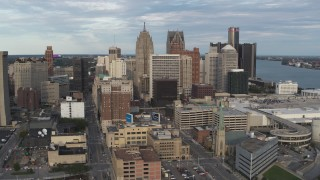 DX0002_196_027 - 5.7K stock footage aerial video descend and orbit of a group of skyscrapers in Downtown Detroit, Michigan