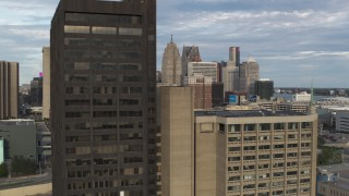 DX0002_196_028 - 5.7K stock footage aerial video flyby a group of skyscrapers to reveal office tower in Downtown Detroit, Michigan