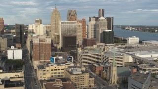 DX0002_196_035 - 5.7K stock footage aerial video of a reverse view of a group of skyscrapers in Downtown Detroit, Michigan
