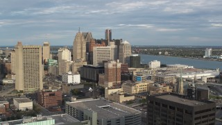 DX0002_196_038 - 5.7K stock footage aerial video of a slow, wide orbit of a group of skyscrapers in Downtown Detroit, Michigan